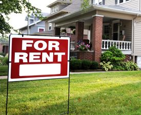 Image of a for rent sign in a front yard